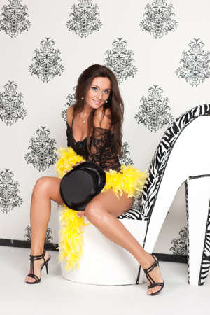 Glamoured portrait of fancy cabare dancer sits on high heel shoe Stock Photo - 16098953