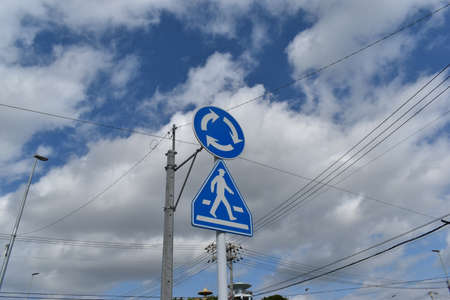 Road sign of rotary (roundabout) in Okinawa, Japan 写真素材