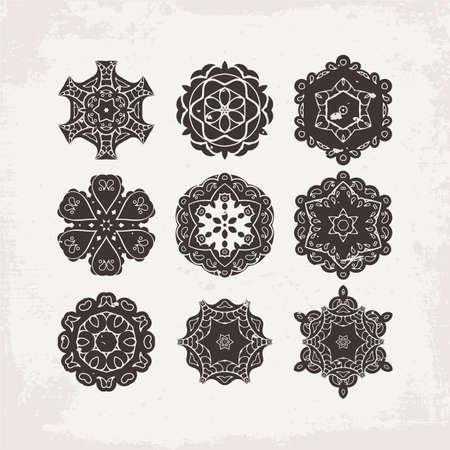 Set of ornate vector mandala symbols. Mehndi lace tattoo. Oriental weave. The circular pattern. Illustration