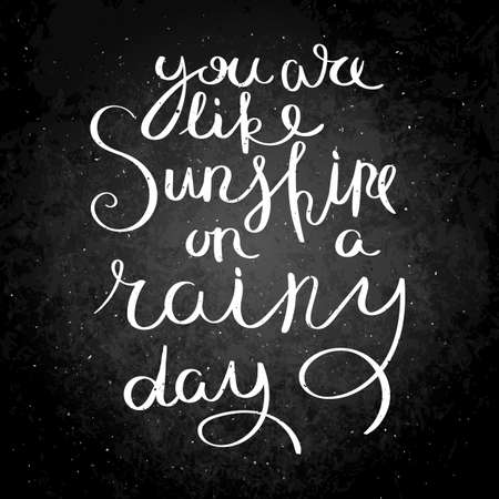 You are like a sunshine in a rainy day. Inspirational vector hand drawn quote. Chalk lettering on blackboard. Motivation saying for cards, posters and t-shirt. 向量圖像