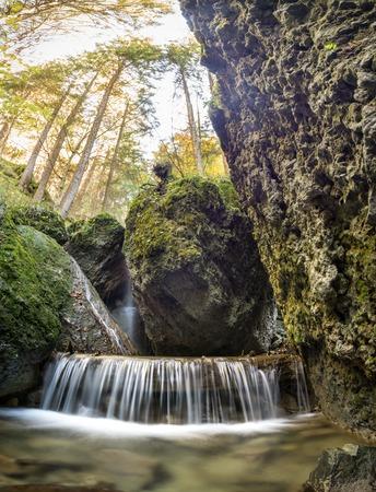 Beautiful waterfall in a narrow gorge. Stock Photo