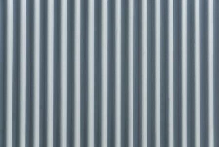 corrugation: Corrugated metal sheet. Bluish background pattern.