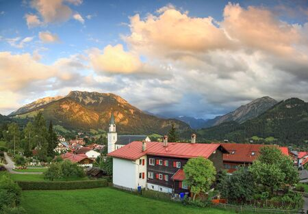 ambience: Beautiful mountain village in evening ambience. Splendid sunset and alpenglow.