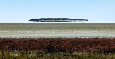 fata morgana: Fata morgana mirage looks like UFO above the desert