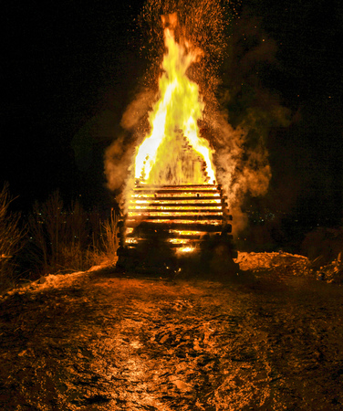 Big huge traditional fire. Burning of witches in a bonfire.