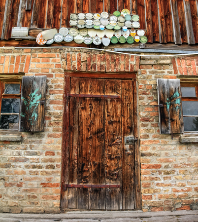 dilapidation: Old fashioned door of farmhouse in the Alps Stock Photo