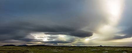 Huge storm in the icelandic highland. Dramatic clouds and sky. Stock Photo
