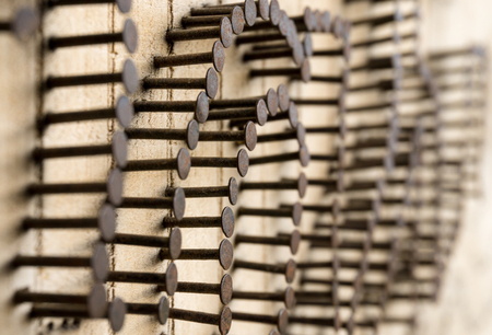 rusty nail: Many Nails nailed into wooden wall. Sticked out nails. Teamwork