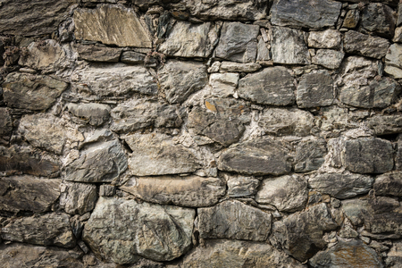 solid: Masoned rock wall of natural stones with nice vignetting Stock Photo