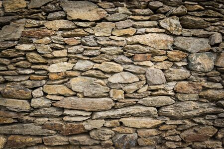 solid: Dry masonry rock wall of natural stones with nice vignetting