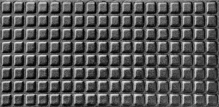 cushioning: Shiny black background, synthetic foamy material with parallel rows. Stock Photo