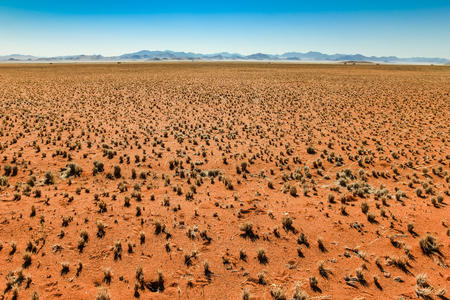 barrenness: Great view over grassy desert plain and mountain range