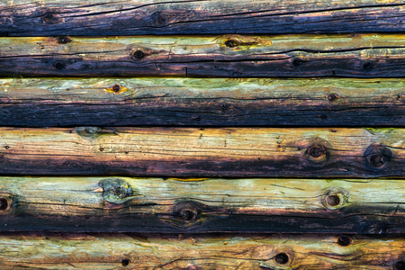 Natural colorful weathered log cabin wood wall. Wooden background pattern.