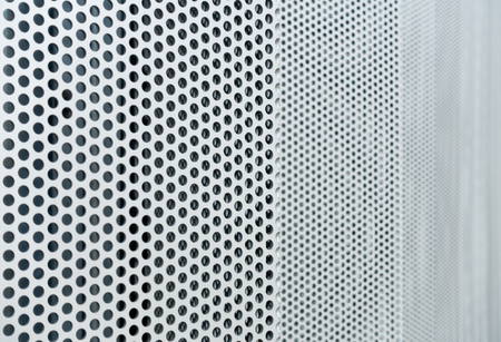 shiny black: Gray metal background, round perforated metal texture Stock Photo