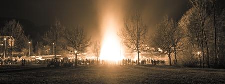 hellfire: People celebration around big huge traditional fire event. Stock Photo
