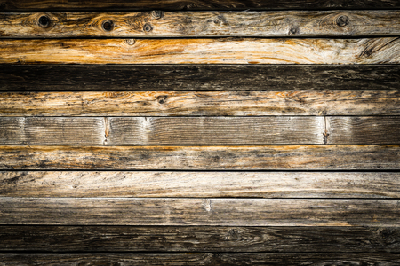 Old natural brown barn wood wall. Wooden textured background pattern.