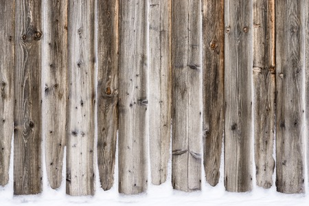 Old vintage wooden wall with snow. Winter and christmas background.