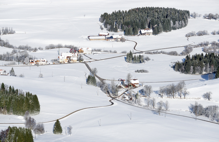 Lovely rural countryside on snowy winter day. Aerial view of barnyards and farm. Weitnau, Allgau, Bavaria, Germany. Imagens