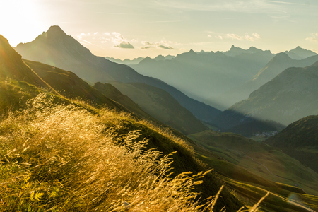 Beautiful sunrise and layered mountain silhouettes in early morning. Lechtal and Allgau Alps, Bavaria and Austria. Imagens