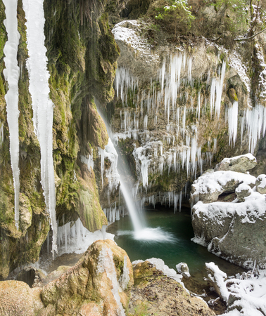 Amazing icicles and waterfall gorge on cold winter day. Hinanger Waterfall, Bavaria, Germany Imagens