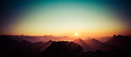 Beautiful Sunset or Sunrise above Mountains with clear sky. Alps, Allgau, Bavaria, Germany.