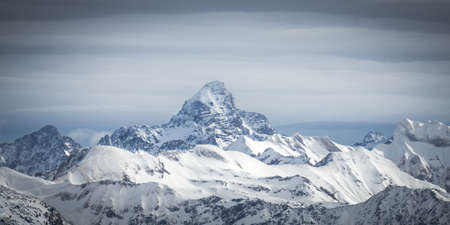 Amazing dramatic Winter panoramic View to the snow covered Mountain Hochvogel in Allgau Alps, Bavaria, Germany. Banco de Imagens