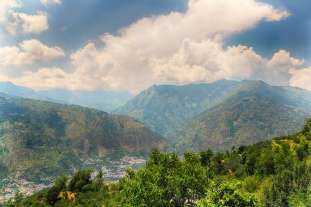 lower section: Landscape of the lower section of the Himalayan mountains in Nepal with the lush green forests in front