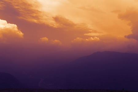 lower section: mountains under mist at the sunset in the lower section of the Himalayan mountains in Kullu valley, Himachal Pradesh, India
