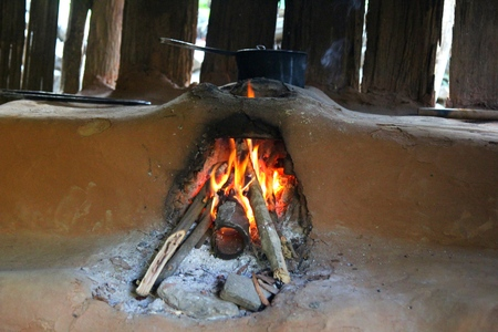 woodburning: Old style traditional nepali stone oven with Blaze of fire  for baking