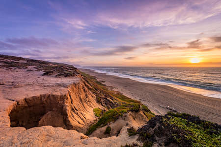 Sunset over cliffs, beach and ocean at Pt. Reyes, CA. Leading lines to horizon.