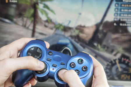 somebody playing a racing game Stock Photo - 15988975
