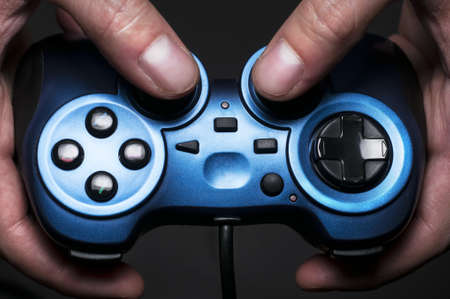 Somebody holding a gamepad Stock Photo