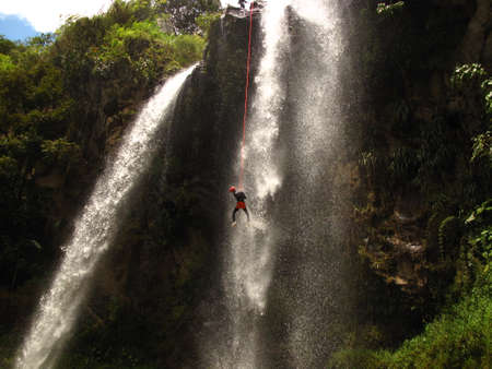 rappel: A man performs rappel in a waterfall