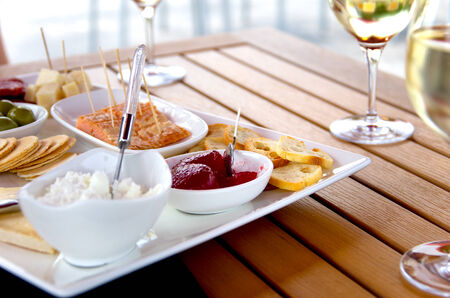 Closeup view of selected wine pairings on a summer patio.