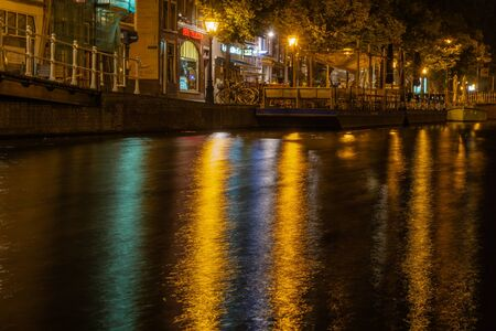 Dutch city center with blurred reflections in water