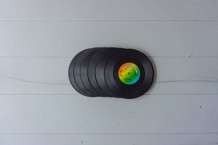 A stack of vintage colorful LP's