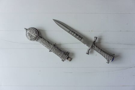 Dagger with holster on white background