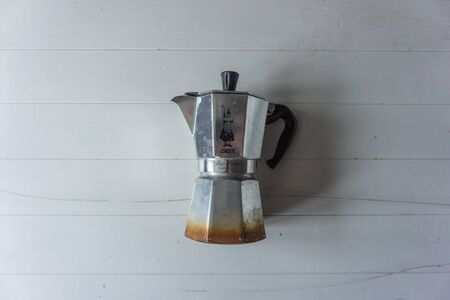 Vintage coffee maker on white striped background