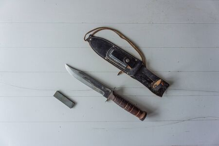 Vintage hunting knife with sharpening steel