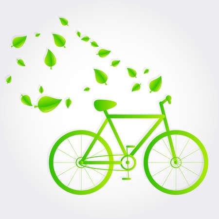 Green bike with leaves flying around. Green transport. Gray background. Ecological bike