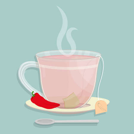 Cup of red pepper tea. Tea sachet with red chilli pepper on the saucer. Smoke on the drink. Spoon in front of cup.