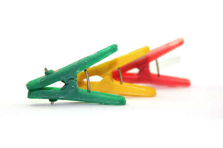 three clothespin with different colors Stock Photo
