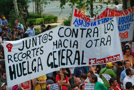 spaniards: SEVILLE, SPAIN – MAY 12: Thousands of Spaniards angered by their grim economic prospects and political handling of the international financial crisis in Seville on May 12, 2012