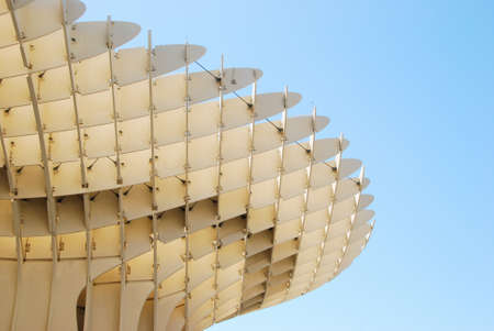 SEVILLE, SPAIN - MAY 9: Detail of Metropol Parasol on May 9, 2012 in Seville,Spain. J. Mayer H. architects, it is made from bonded timber with a polyurethane coating