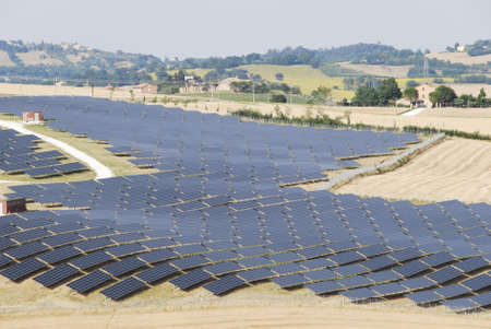 Solar panels for renewable energy with Marche region landscape Stock Photo - 14461110