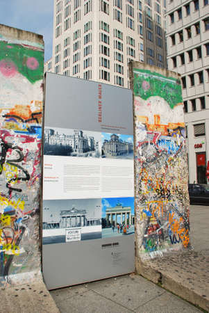 unification: BERLIN, GERMANY - AUGUST 17: Painting on a preserved segment of the Berlin wall (1961-1989) on August 17, 2012 in Berlin, Germany.