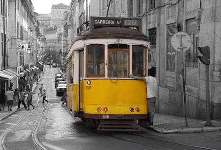 lisboa: The traditional yellow tram in Lisbon (Portugal) Editorial