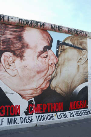 fraternal: BERLIN, GERMANY - AUGUST 18:Painting of Dmitri Vladimirovich Vrubel on a preserved segment of the Berlin wall (1961-1989) at East Side Gallery on Aug 18, 2012 in Berlin, Germany.