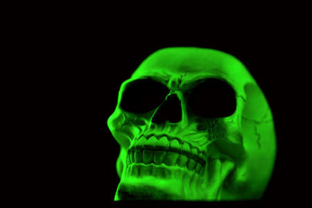 Green skull glowing by its own phosphorescence