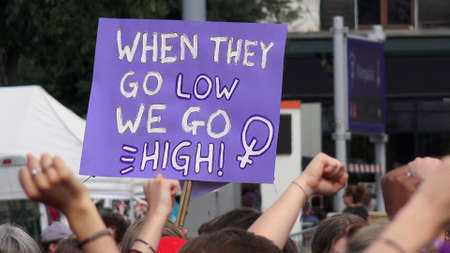 When they go low we go high. Slogan brandished at the feminist strike.